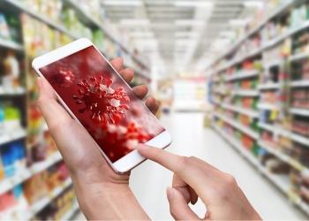 Smartphone con fondo de pantalla 3D Coronavirus o Covid-19 en una supermercado.
