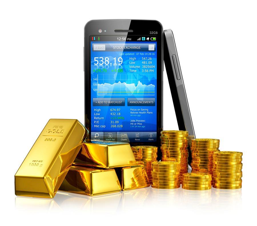 Teléfono inteligente con aplicación del mercado de valores, lingotes de oro y monedas de oro.