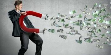 El empresario atrae dinero con un gran imán