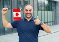 Man with the flag of Canada. Good business is a Canadian entrepreneur.